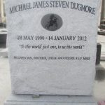 Grey memorial headstone with laser etched portrait