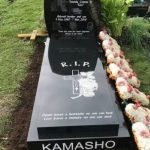 Memorial headstones for African black British people. Laser etched black granite kerb